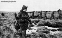 Falklands_War_Scots_Guards_bring_in_Argentine_prisoners_from_Tumbledown.jpg