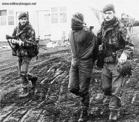 Argentine officer is escorted after being captured.jpg