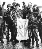 C Coy., 3 Para, unfurl their company flag after marching into Stanley on June 14th, 1982, the day of the Argentine surrender..jpg