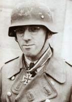 Karl Rossmann stahlhelm leather jacket ledermantel award ceremony knights cross glasses.jpg